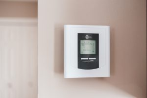 Thermostat sitting on wall